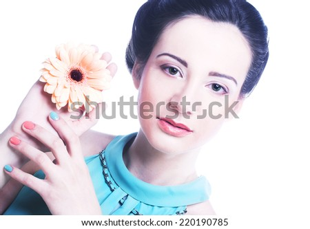 Young woman in blue dress posing with flowers - stock photo