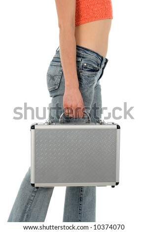 Young woman in blue jeans with metal suitcase. - stock photo