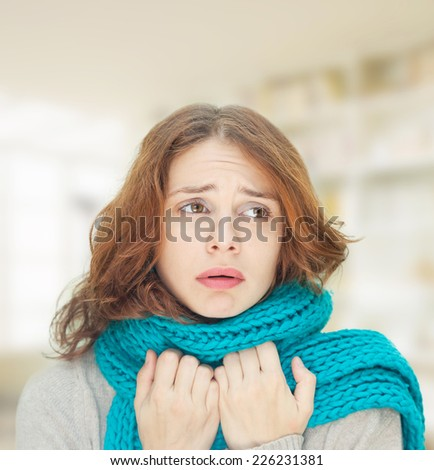 young woman in blue scarf is sick cold - stock photo