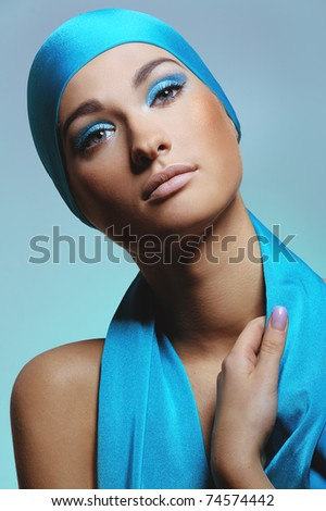 young woman in blue scarf  on the head with health skin of face - stock photo