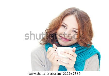 young woman in blue scarf with white mug isolated on white background - stock photo