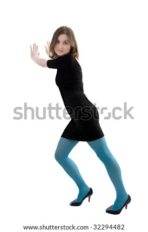 Young woman in blue stockings leaning against a wall, shot on white background. - stock photo
