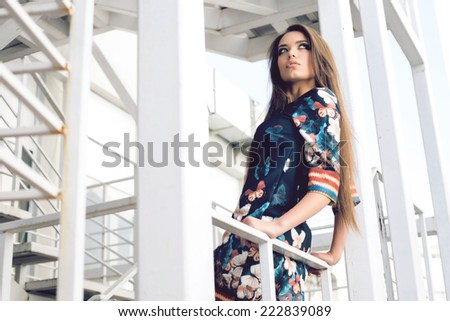 young woman in blue summer dress with butteflies, outdoor shot - stock photo