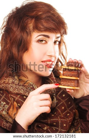 Young woman in brown dress and with cake