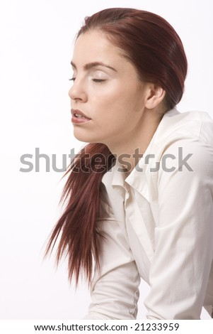 Young woman in business attire closing her eyes in exhaustion