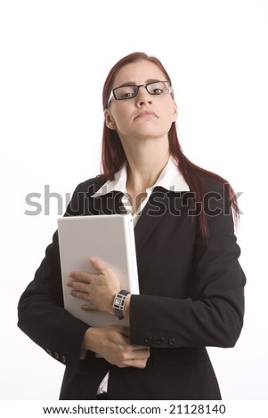 Young woman in business attire standing with a laptop computer and prudish look