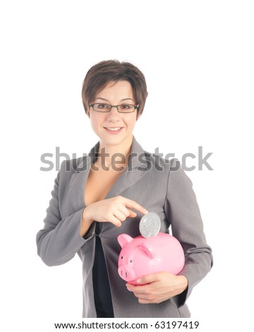Young woman in business suit dropping quarter dollar coin into pink piggy bank