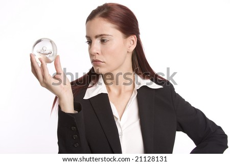 Young woman in business suit holding crystal ball in her hand - stock photo