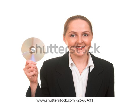 Young woman in business suit showing CD or DVD or other disc smiling isolated on white - stock photo
