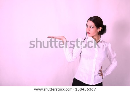 young woman in business suit shows her empty palm - stock photo