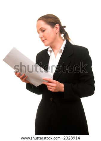 Young woman in business suite thoughtfully reading documents - stock photo
