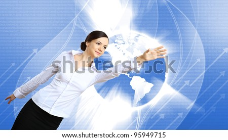 Young woman in business wear with touchscreen technology background - stock photo