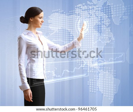 Young woman in business wear with touchscreen technology background