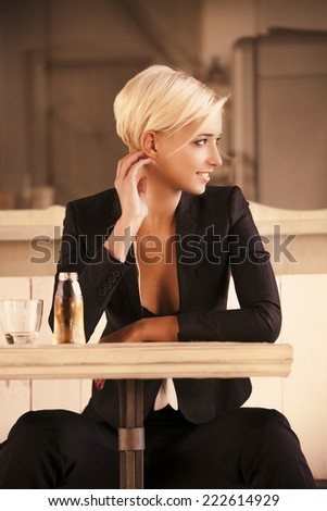 young woman in caffee looking aside - stock photo