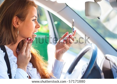 Young woman in car make-up. - stock photo
