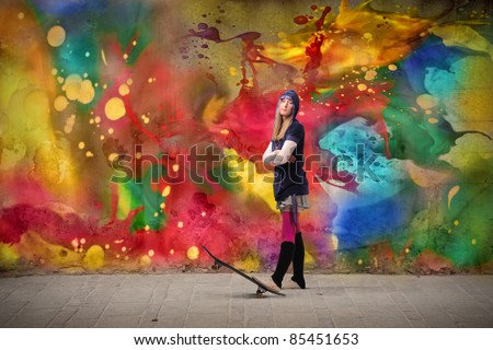 Young woman in casual clothes with a skateboard - stock photo