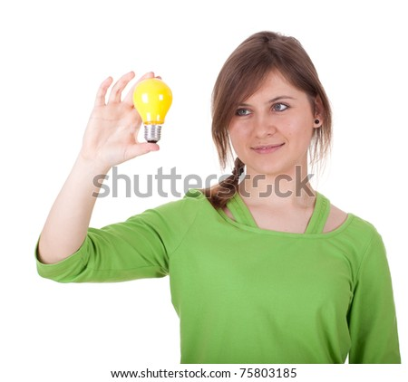 young woman in casual green shirt with yellow lightbulb - stock photo