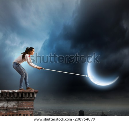 Young woman in casual holding moon on lace - stock photo