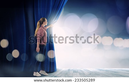Young woman in casual opening stage curtain - stock photo