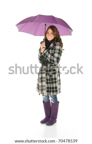 Young woman in casual outfit with umbrella smiling - stock photo