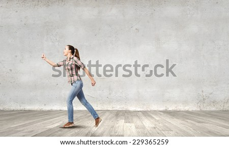 Young woman in casual running in a hurry - stock photo