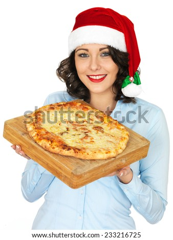 Young Woman in Christmas Santa Hat Holding a Cooked Whole Pizza - stock photo