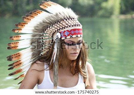 Young woman in costume of American Indian