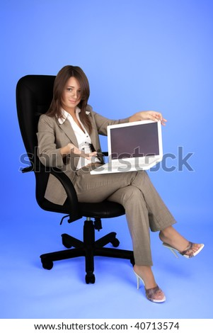 Young woman in costume with laptop - stock photo