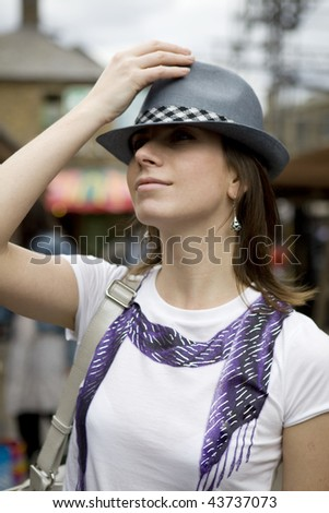 Young woman in cowboy style in the street