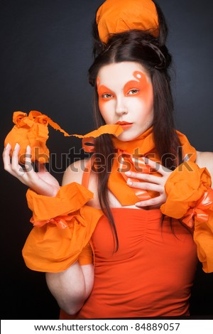 Young woman in creative image and with face-art - stock photo