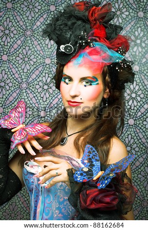 Young woman in creative image with decorative butterflies