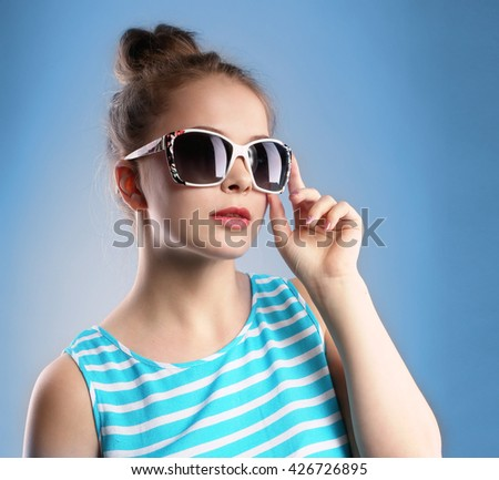 Young woman in dark glasses.