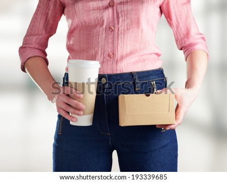 Young woman in deep blue jeans holding a coffee set. Retro style. - stock photo
