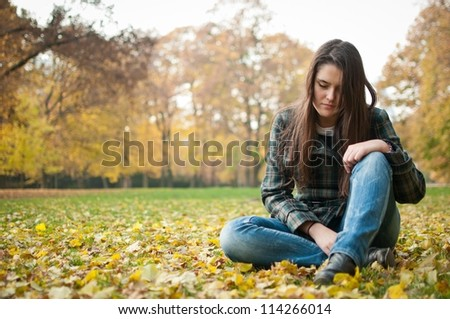 Young woman in depression outdoor