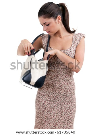 young woman in dress looking to bag