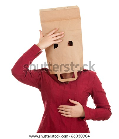 young woman in ecological paper bag on head suffering from pain -  headache