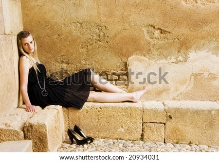 Young woman in elegant black dress. - stock photo