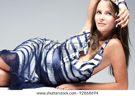 young woman in elegant summer dress, studio shot - stock photo