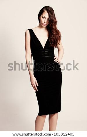 young woman in elegant tight evening dress studio shot - stock photo