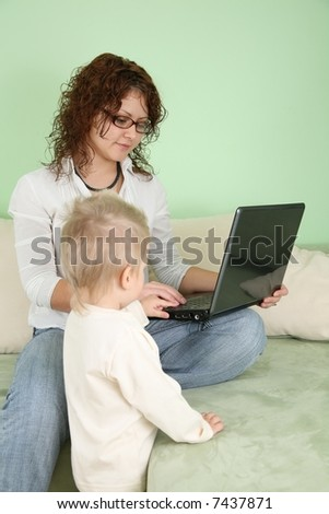 young woman in eyeglasses with notebook and child - stock photo