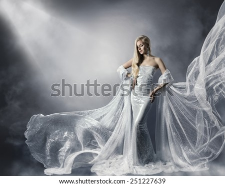 Young Woman in Fashion Shiny Dress, Lady in Flying Clothes, Girl under Star Light, Shiny Cloth Fluttering and Flowing - stock photo