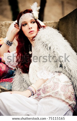 young woman in fashionable white clothes  sit on stairs, outdoor shot - stock photo