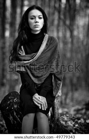 Young woman in forest. Black and white concept. - stock photo
