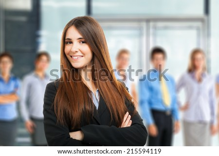 Young woman in front of a group of people - stock photo