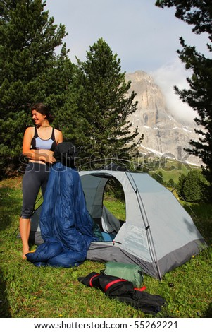 Young woman in front of a tent - stock photo