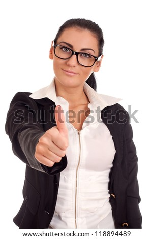 Young woman in glasses gesturing OK - stock photo
