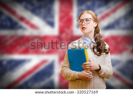 Young woman in glasses holding files on english flag background - stock photo