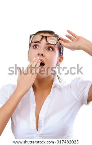 Young woman in glasses is surprised, isolated on white background. - stock photo