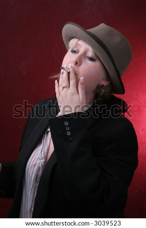 young woman in gray hat  smocking cigarette