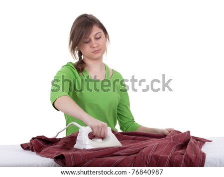 young woman in green blouse ironing clothes, housework - stock photo